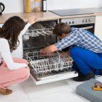 dishwasher technician fixing the dishwasher in the kitchen