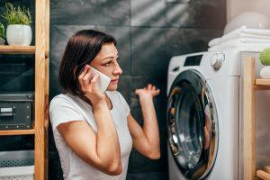 woman is calling dryer repair service